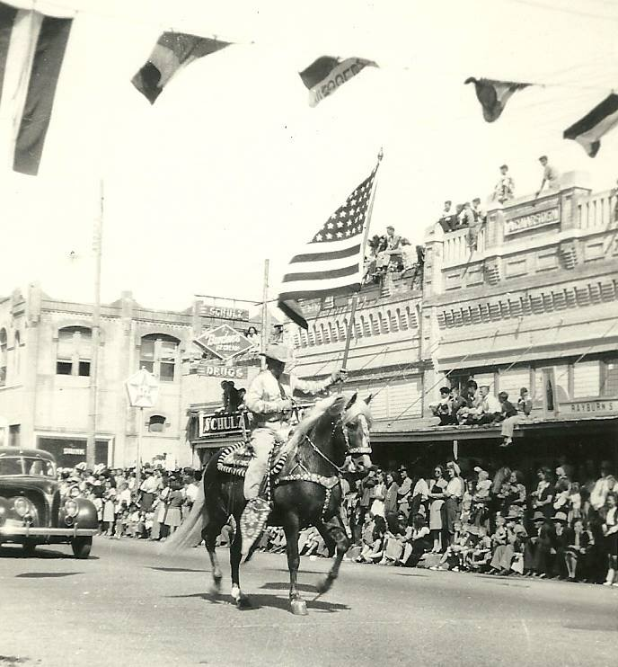 Downtown Beeville Parade 1946 taken by James Beauchamp. Courtsey of the Will Beauchamp Collection.