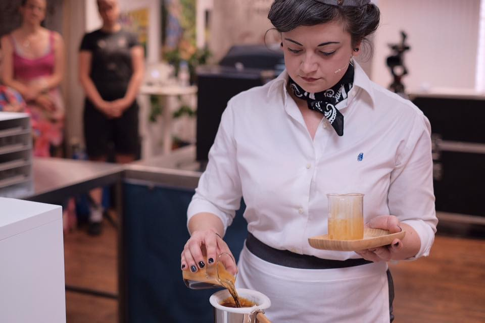 Estelle Bright is no stranger to the many sides of the coffee industry. - Estelle on stage in the 2017 UKBC. Photo: @allthesinglelattes.