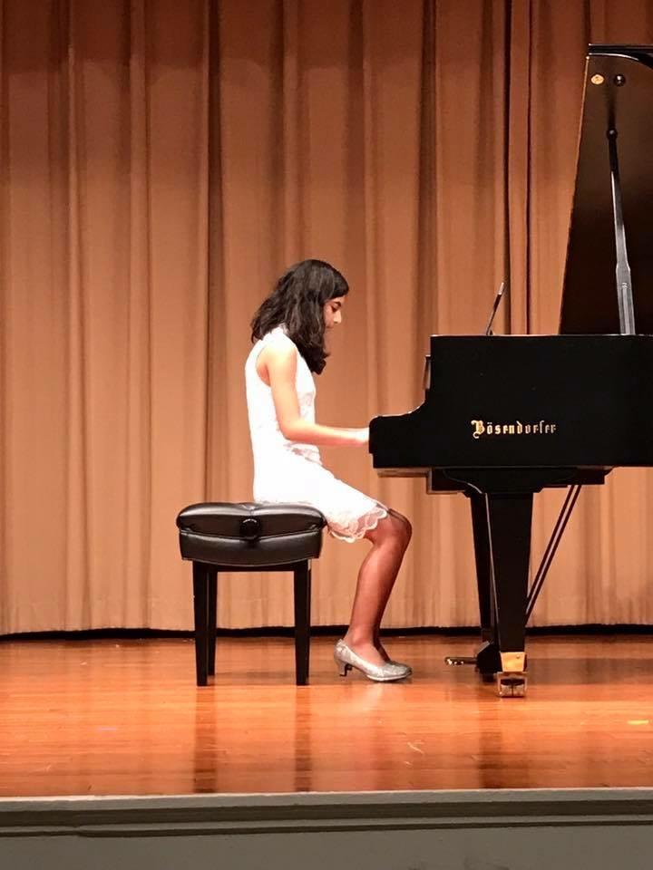 Raha performing.JPG