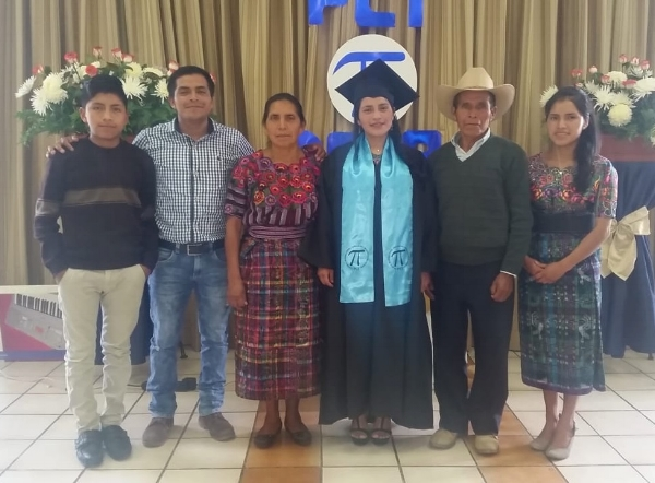 Angélica (middle) with her family at graduation, June 2018