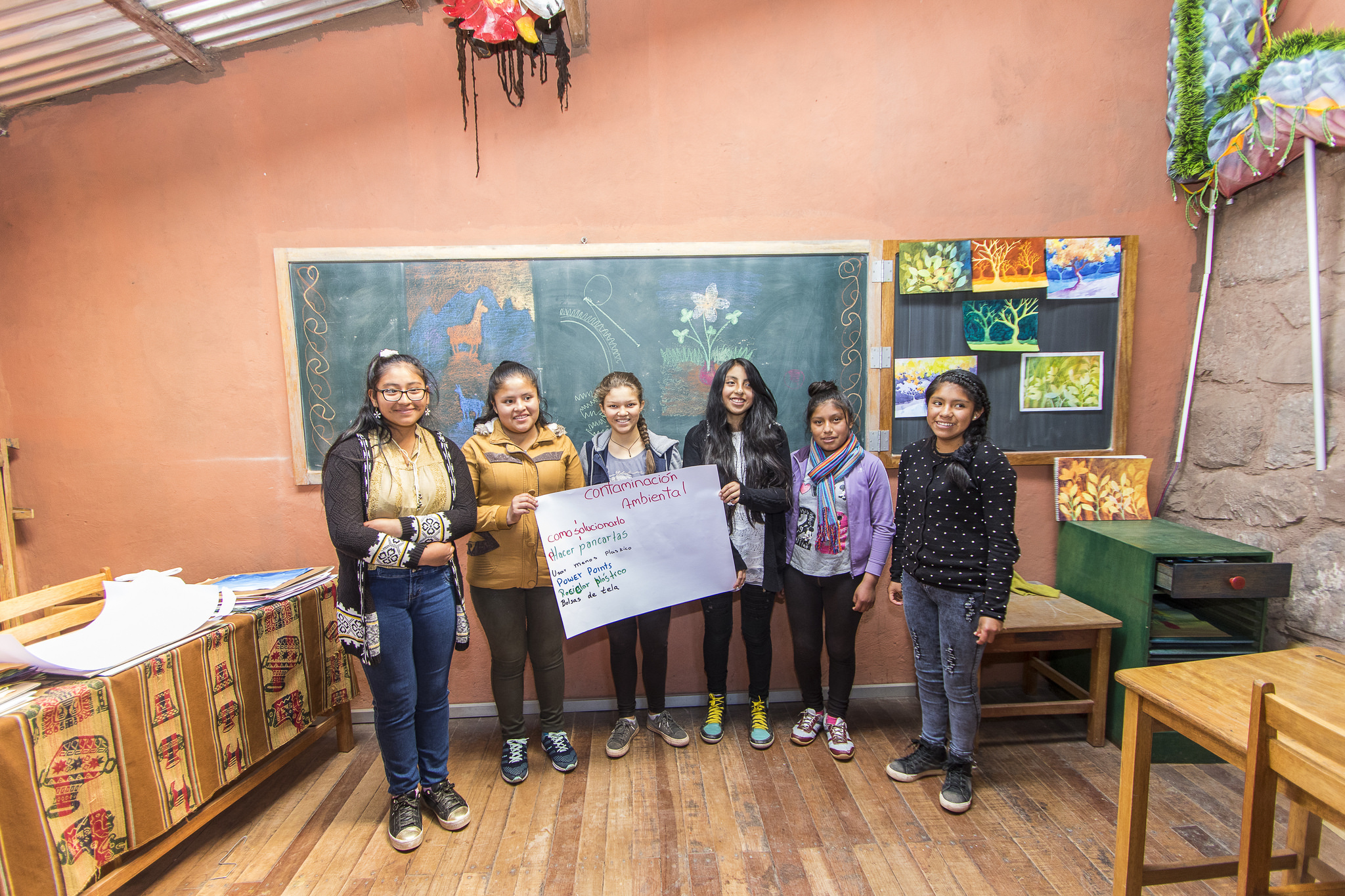"""Women Who Will Change the World   This is Flavia's girls' group. They meet weekly with their mentor, Indira. They're currently working on an awareness campaign about environmental contamination and paying attention to the upcoming mayoral election.  They say group work is important because """"each person is a key part of it and that makes us strong and motivates us.""""    DONATE HERE!"""