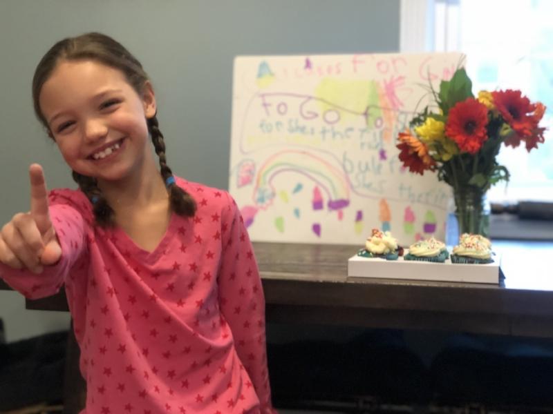 Charlotte celebrating her eighth birthday with #BakeAChange, post-cupcake decorating