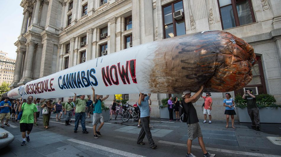 Cannabis supporters roll out 51-foot joint outside the 2016 Democratic convention.   Photo courtesy of Mashable