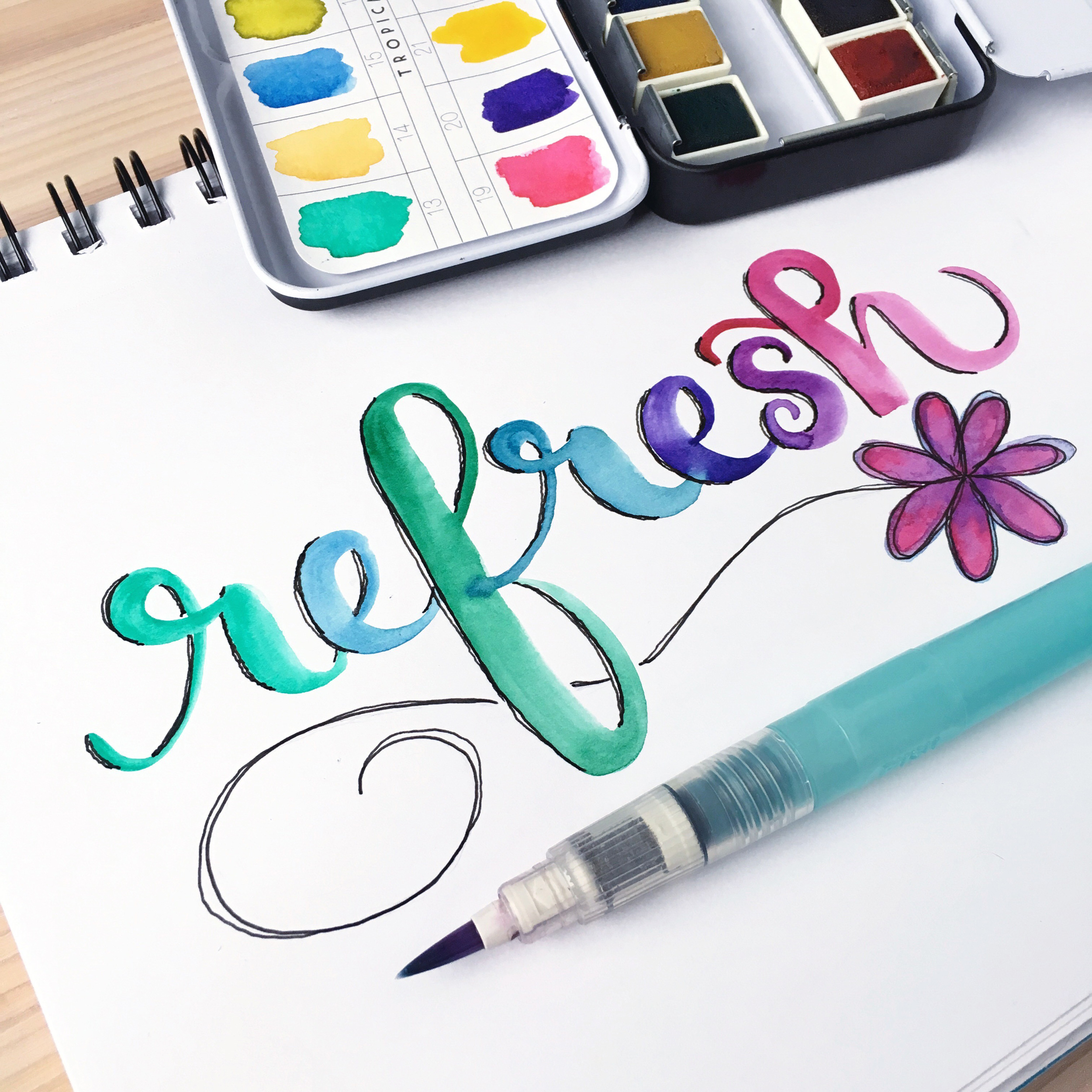 Dani Claire. Artsy Goodness. My New Favorite Watercolor Set. Waterbrush. Prima Watercolor Confections. Watercolor Art. Watercolor Paints. Hand lettering. Hand letterer. Watercolor lettering. Word of the Year. Refresh. Watercolor Daisy.