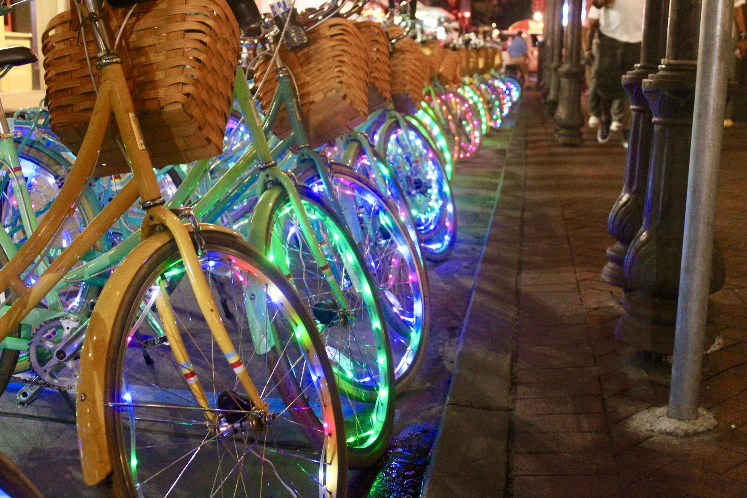 Night bike ride with glowing wheels in Nola.