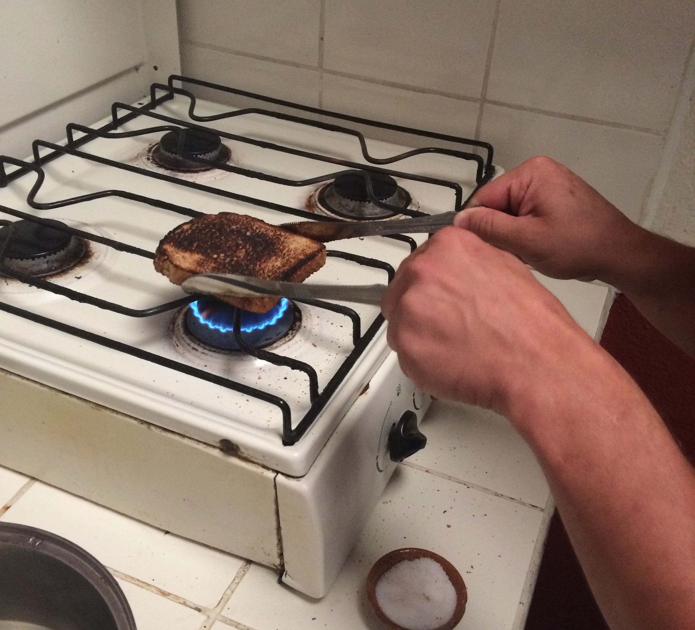 Hostel kitchens are very basic, often with no toaster or microwave.  An example of our MacGyver cooking at its finest.
