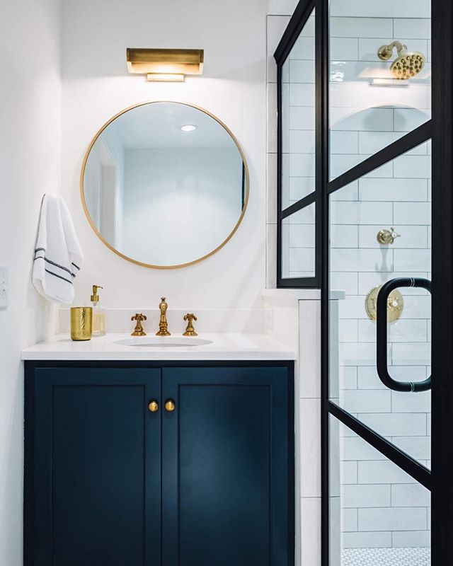 Timeless but traditional. Fresh yet familiar. My specialty: blending old and new, finding creative solutions to challenging spaces, and listening so that I really hear what my clients want and need in their spaces.  #timelessdesign #interiorinspo #designedbyjoy #roundmirror #blackframedglass #showerdoors #tinybath #goldfixtures #colorcrush #navyandblack #navyandgold #renovate #home #newhome #womanarchitect #ladyboss #minneapolis #lowryhill