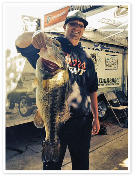 Sean Bias brings in the derby's biggest fish. Photo by Andy Cuccia