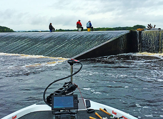 Spillways are common on the Upper Mississippi. Check out the brave anglers fishing for perch.