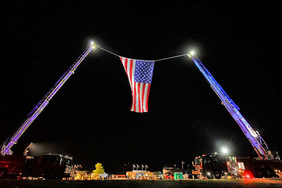 The local fire department raised this magnificent flag for our morning anthem.