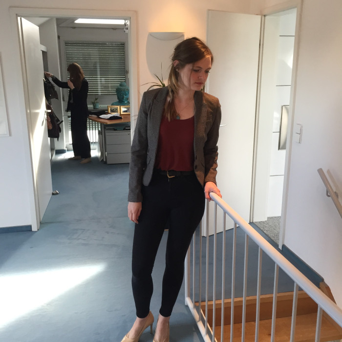 Lily wears a wool jacket courtesy of   re:fashion  , a terracotta shirt, black 'Jamie' jeans from Topshop and nude court heels from Dune. A black belt defines the waist while a vintage necklace adds a sparkle to the neck.