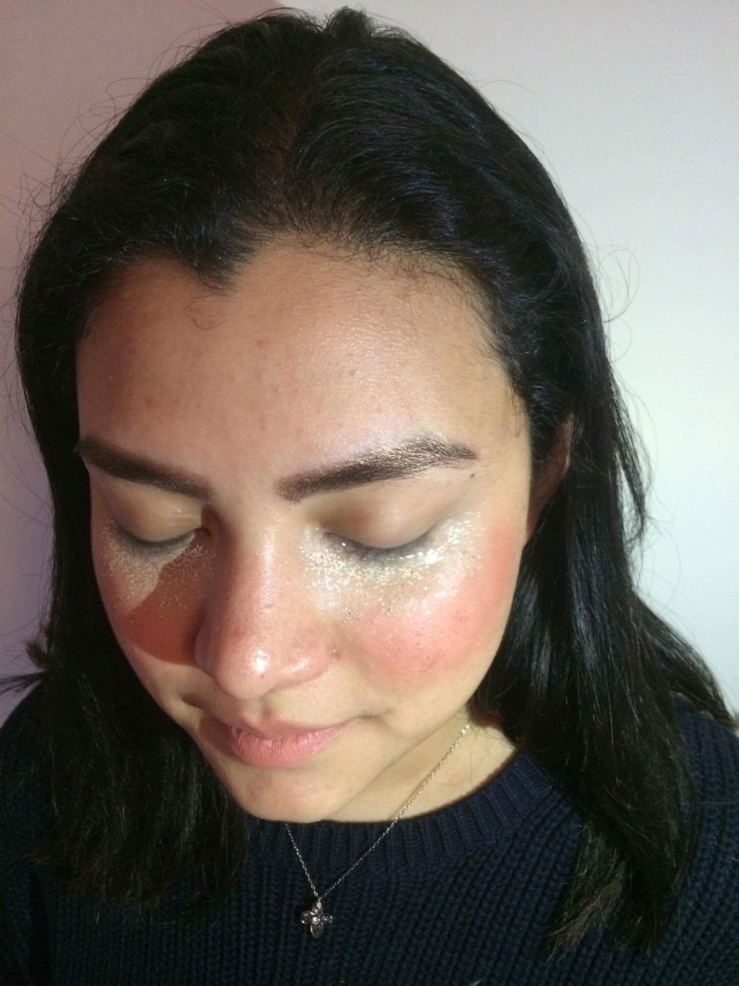 Sargui Magandran shows off the glitter concealer technique. Her eyebrows are filled in with a gold glitter eyeshadow (the same as on the cheeks of Nicole Ip), and on her cheeks is Bite Beauty Multistick in Almond.
