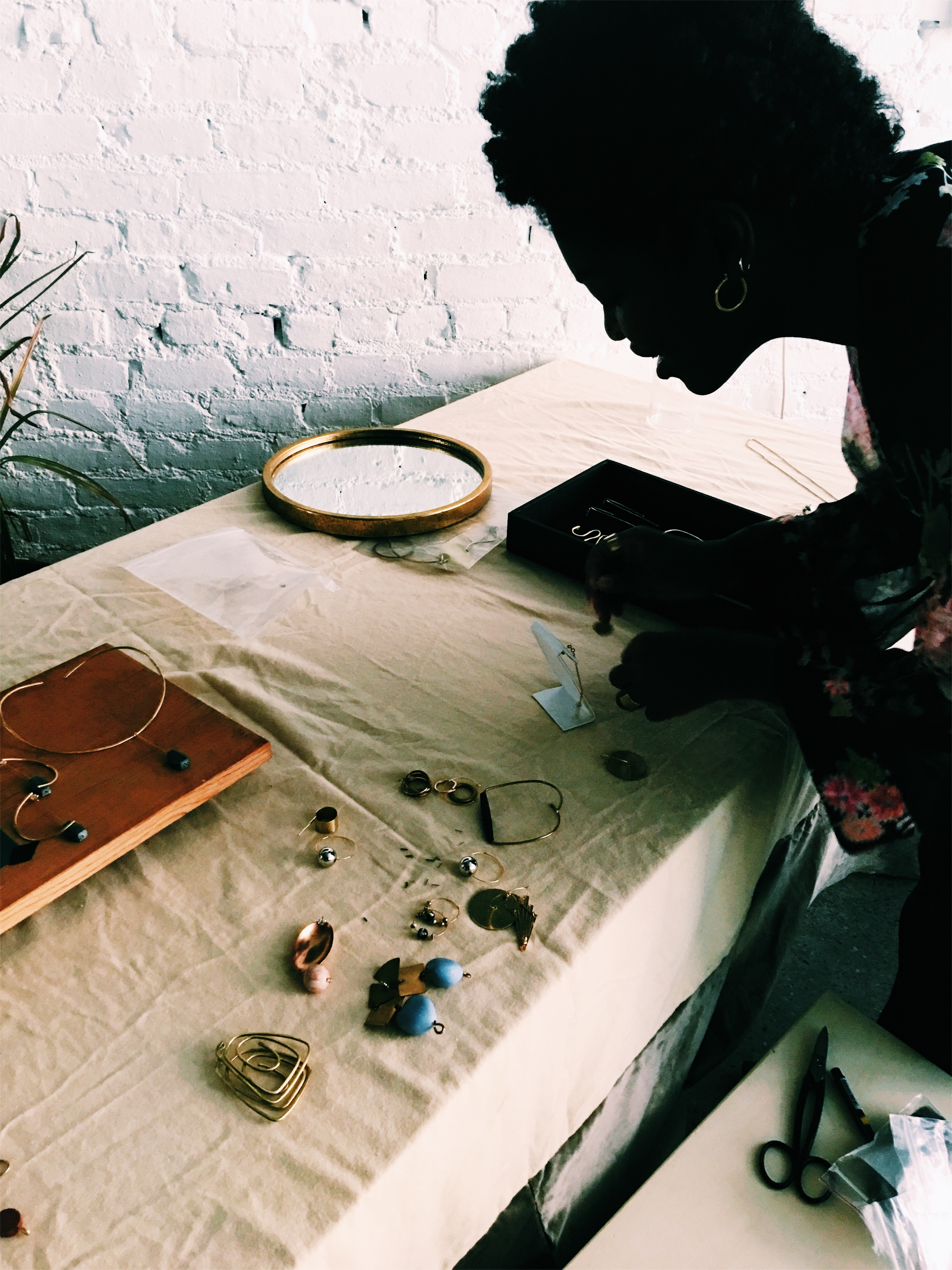 Sade, setting up her table for her jewels,  Edas Jewels .
