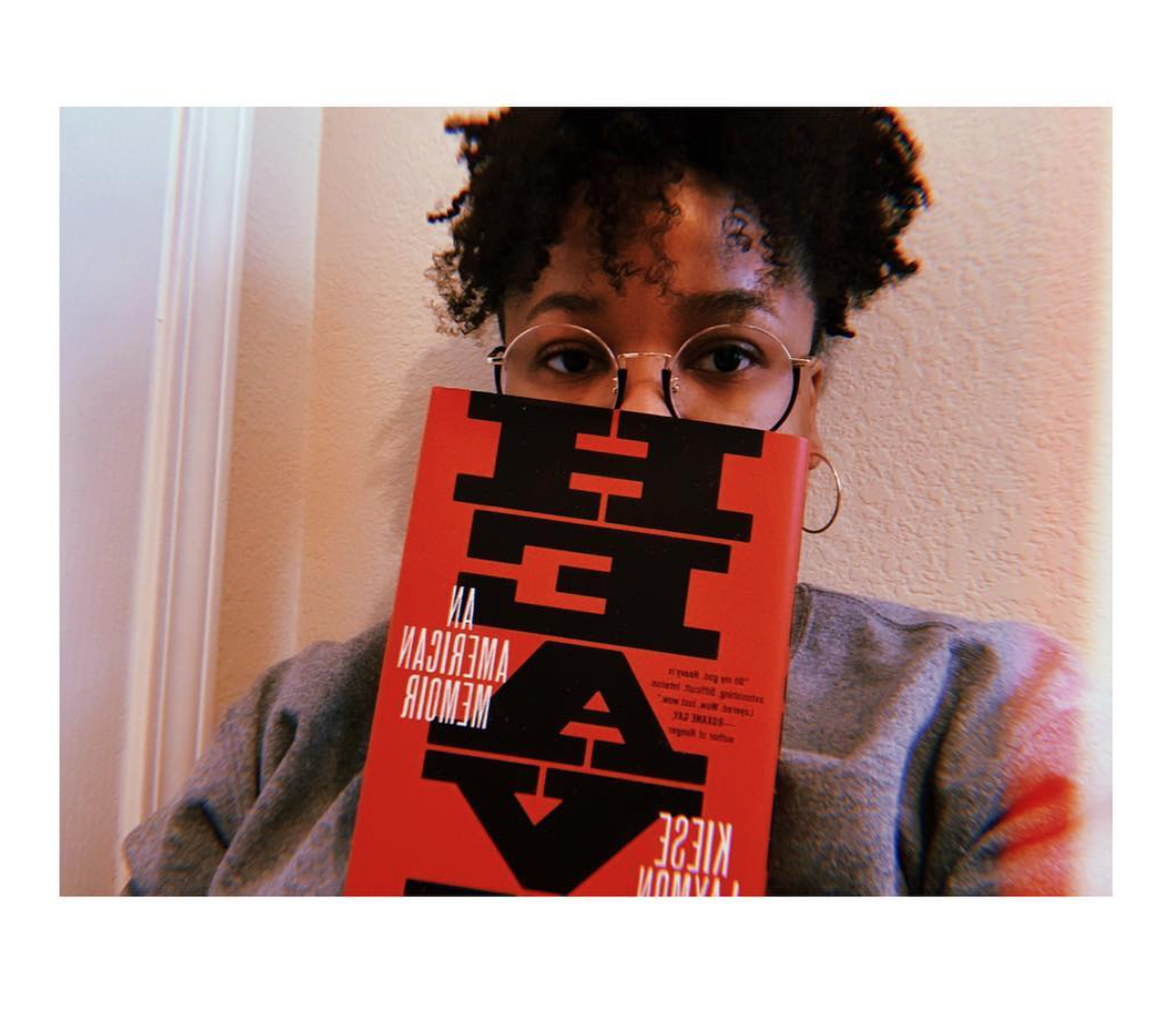 Jessica with Heavy, one of the most impactful books she's read. Click the image to see it on Amazon!