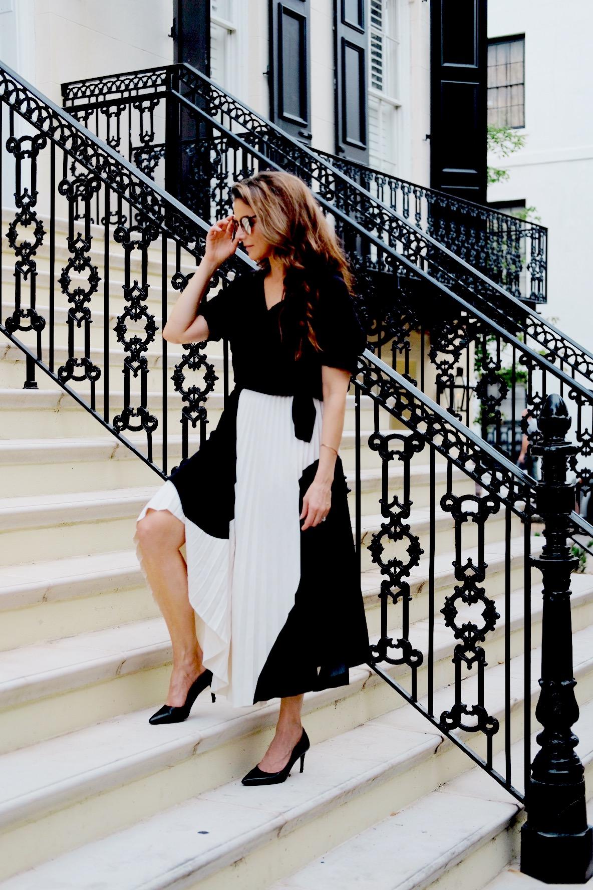 Brenna Lauren Michaels in Black and White Skirt on marble staircase in Savannah, Georgia