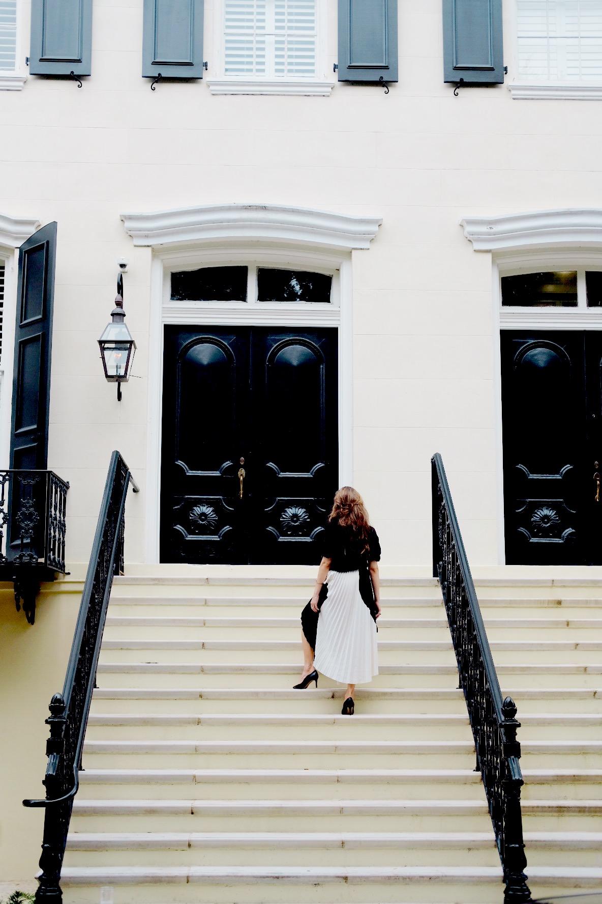 Brenna Lauren Michaels standing on marble stairs in Savannah, Georgia