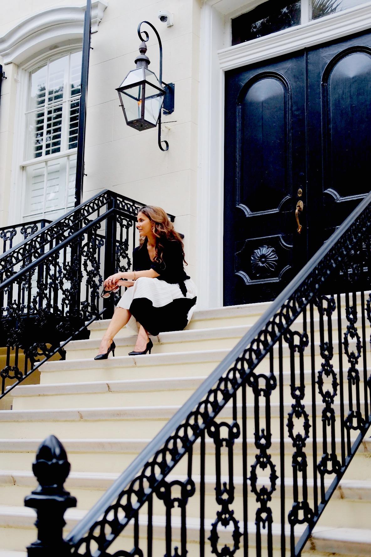 Brenna Lauren Michaels sitting on stairs in Savannah, Georgia
