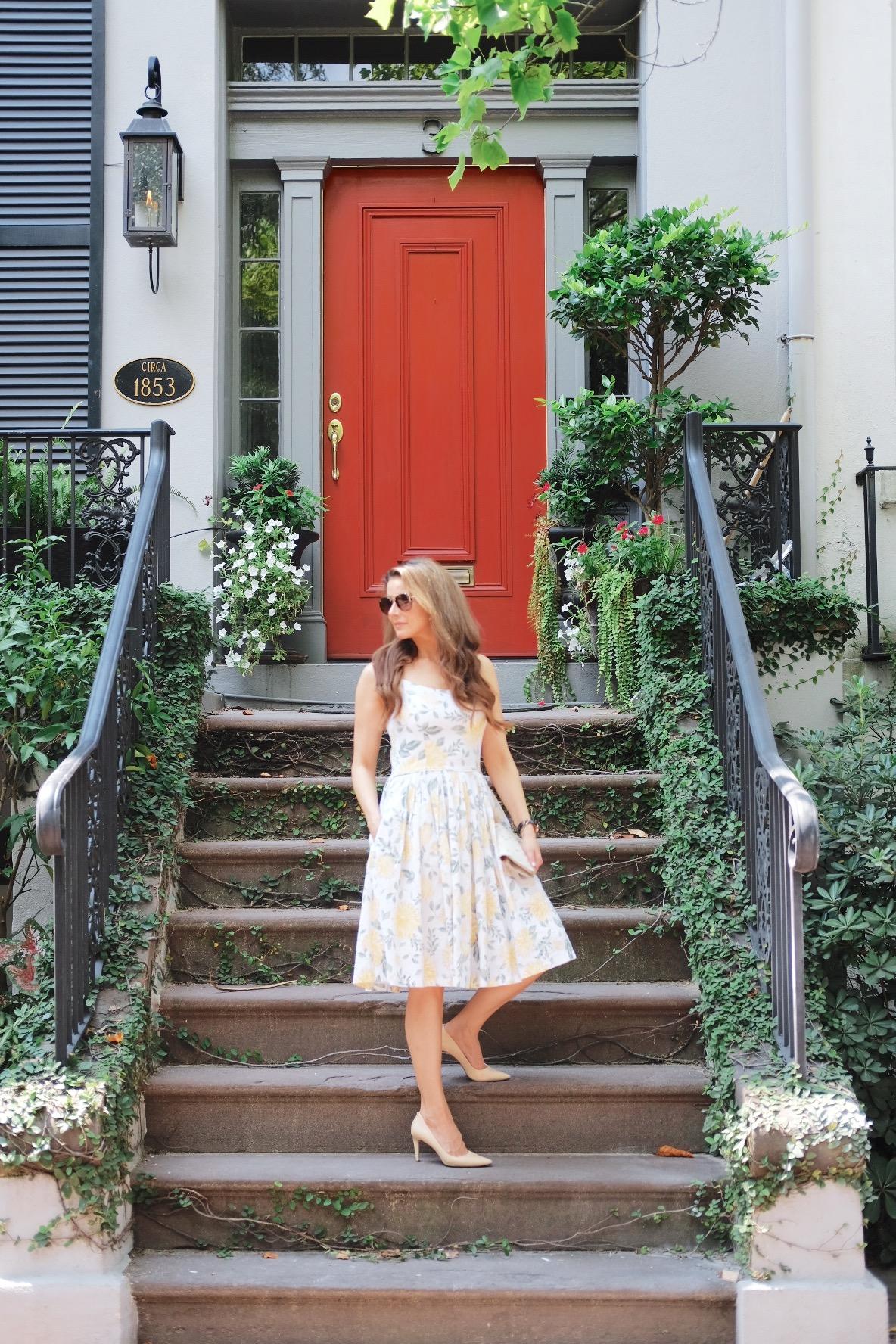 Brenna Lauren on steps in front of red door Savannah, Georgia