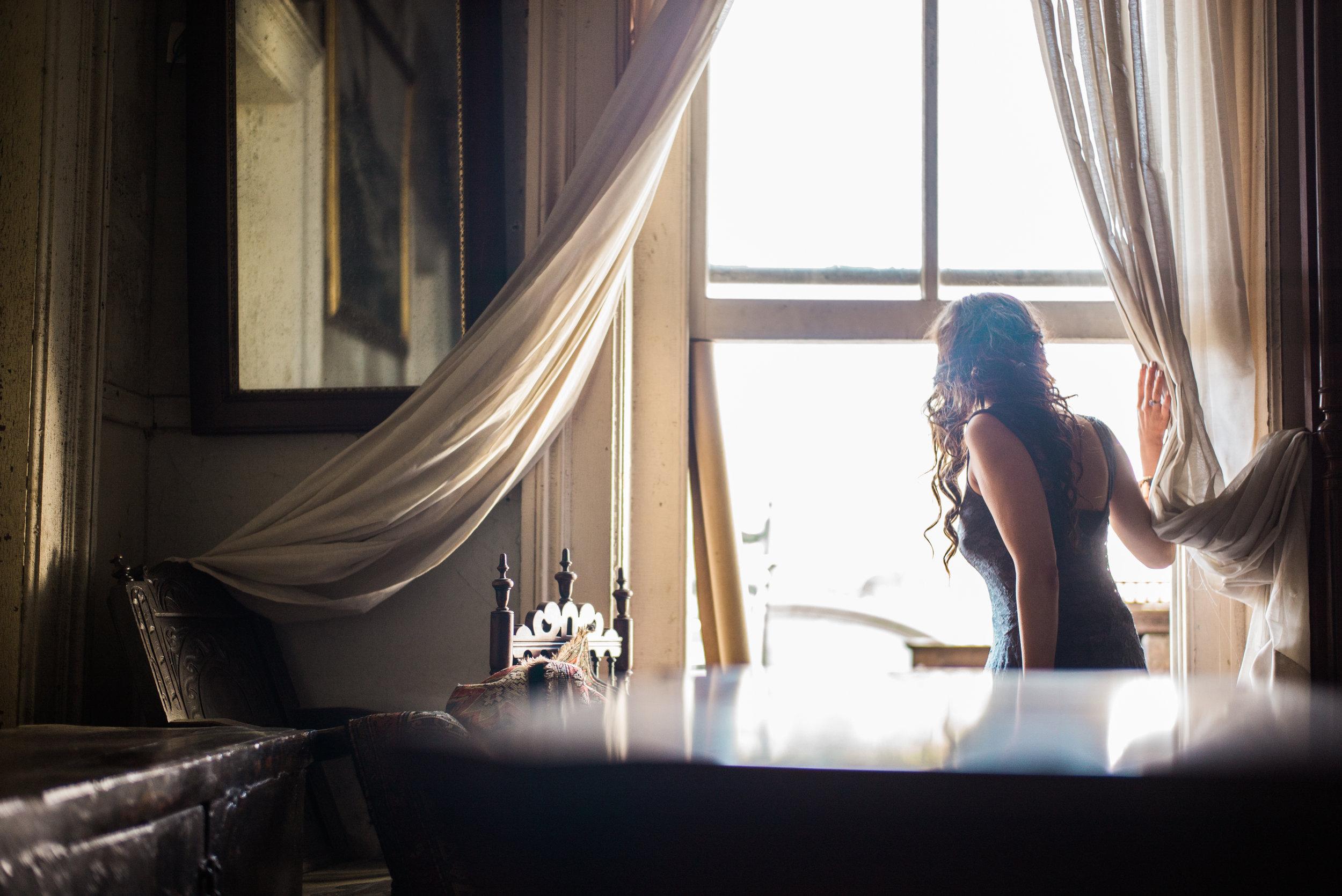 Brenna Michaels looking out window in Savannah