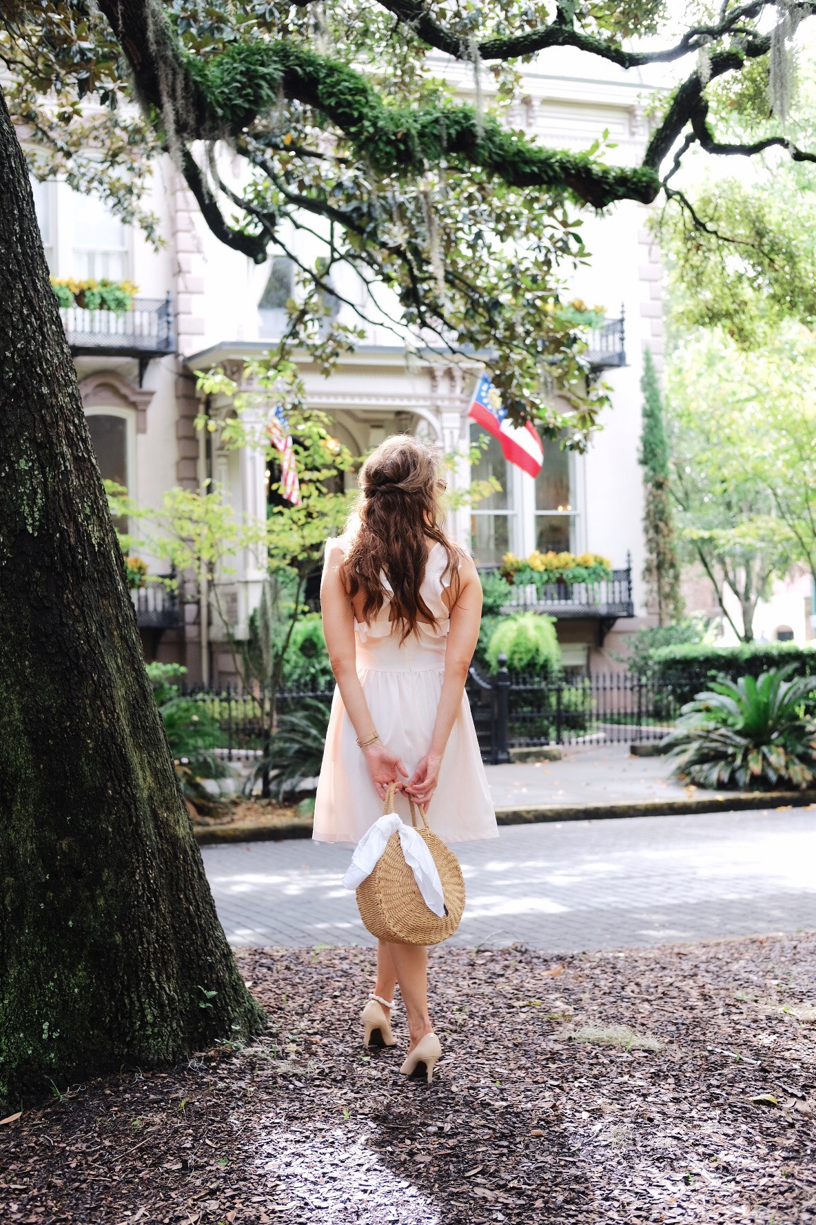Brenna Michaels of Genteel & Bard stands beside a Live Oak tree in Savannah GA