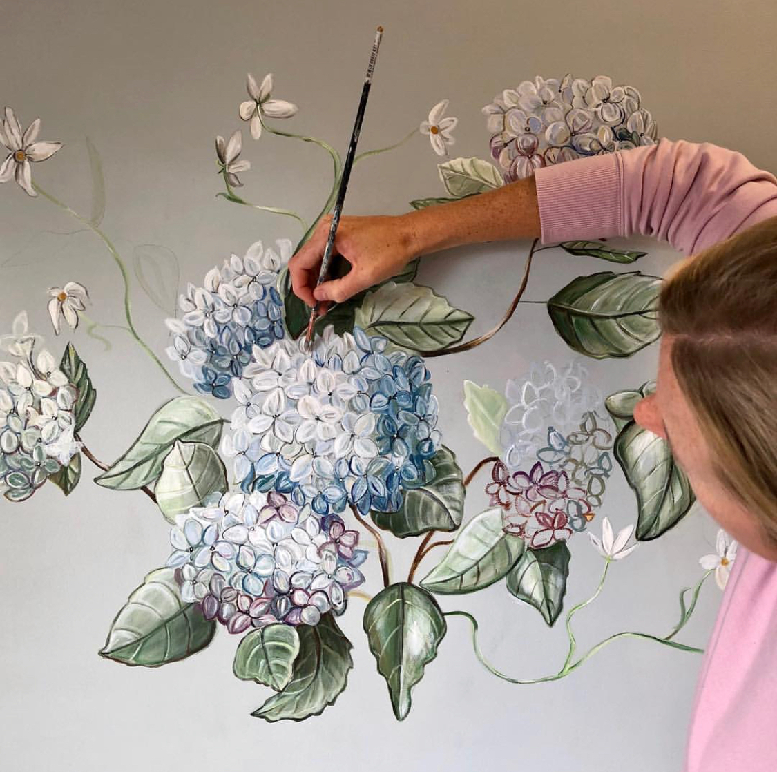 Acrylic Painter and Resin Artist, Mary Margaret Monsees works on a commissioned Hydrangea piece, photo courtesy of her Instagram,  @mstudio
