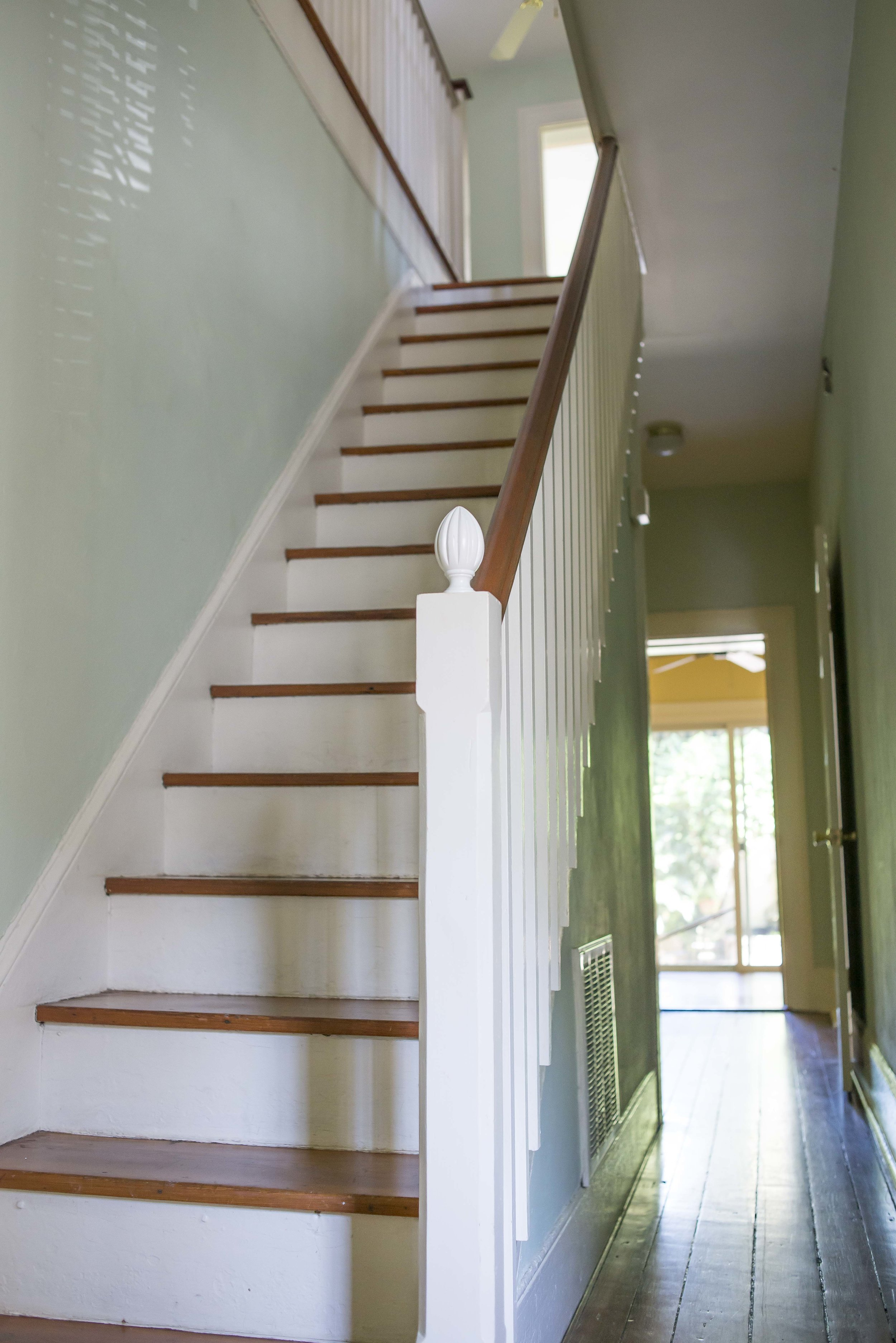 Yes, that is a curtain rod cap on the banister . . . lord have mercy