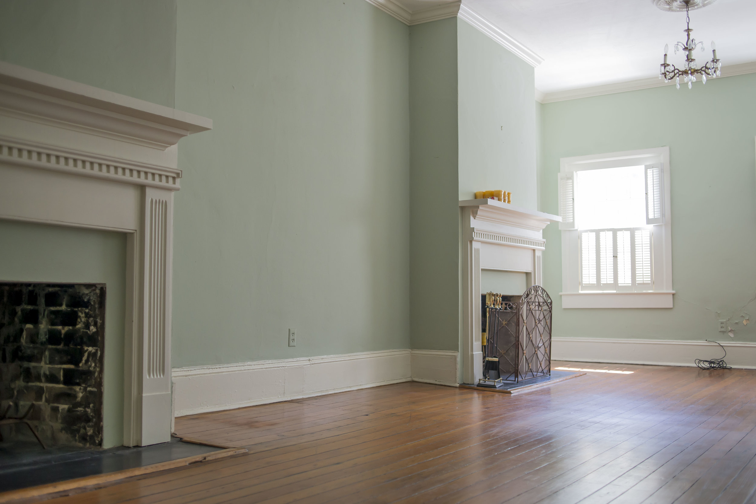 The double parlor is such a fun feature. We knew the paint color would change, of course, everything from the floors to the ceilings needed to be refinished and reimagined, with preserving the original design at the front of our minds.