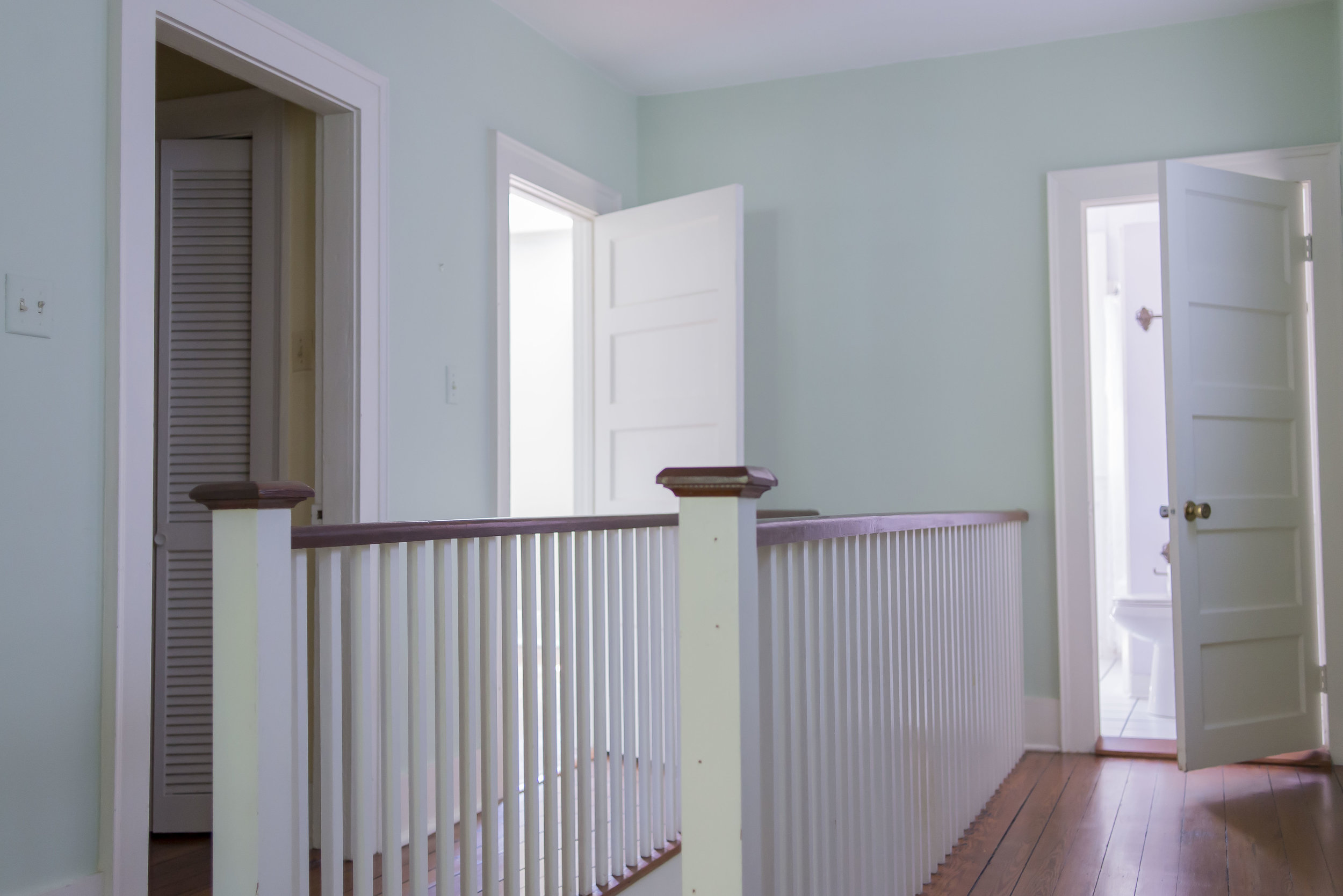 The upstairs hallways were charming, but the arrangement of the master bathroom entry, and the narrow unusable spaces created awkward energy at the top of the landing.