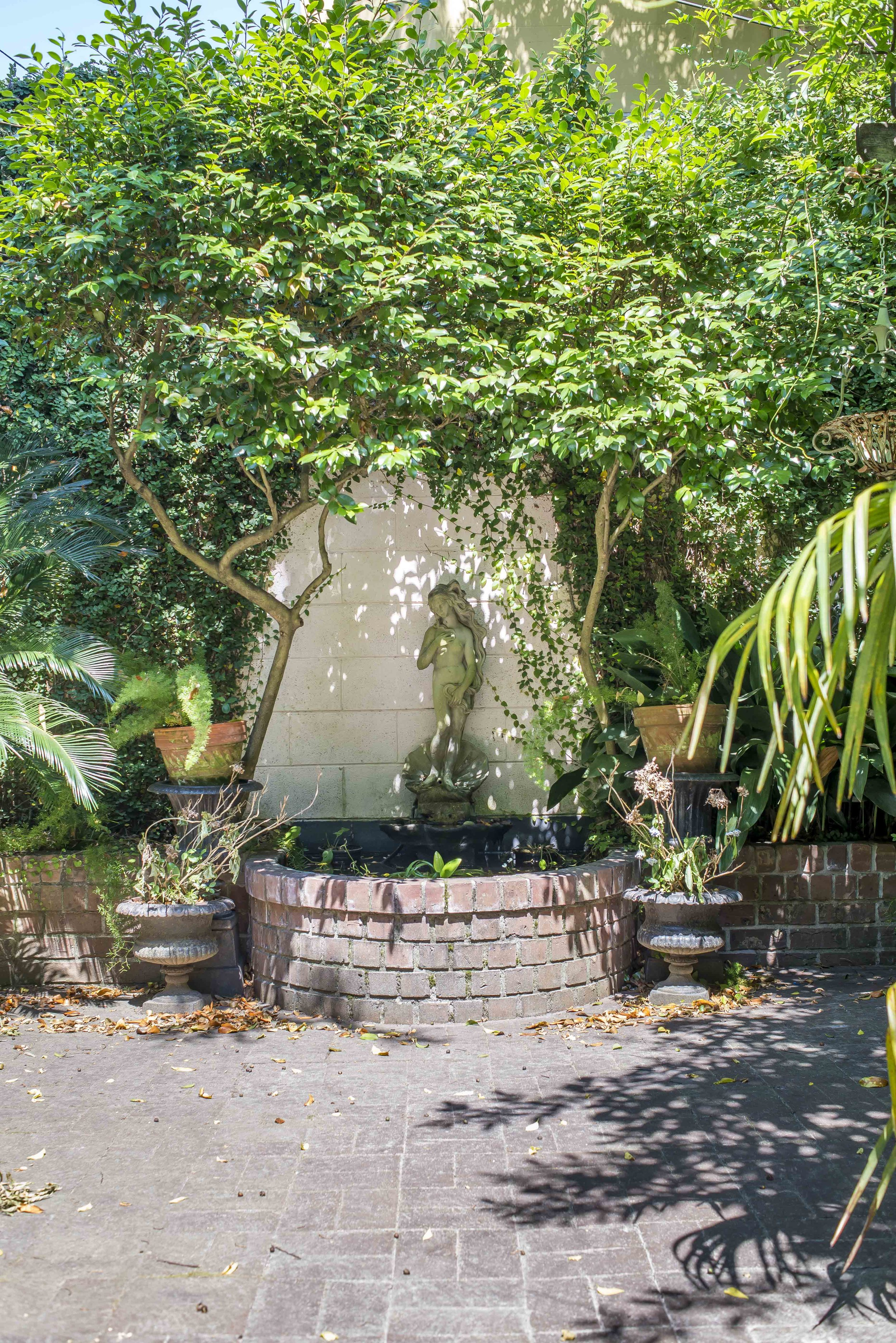 The courtyard garden is one of our favorite features of the house, complete with fountain and wisteria-covered pergola, it's a gardener's dream - and Rhett Jagger and I can't wait to get out there to clear out the old and bring in the fresh flowers.