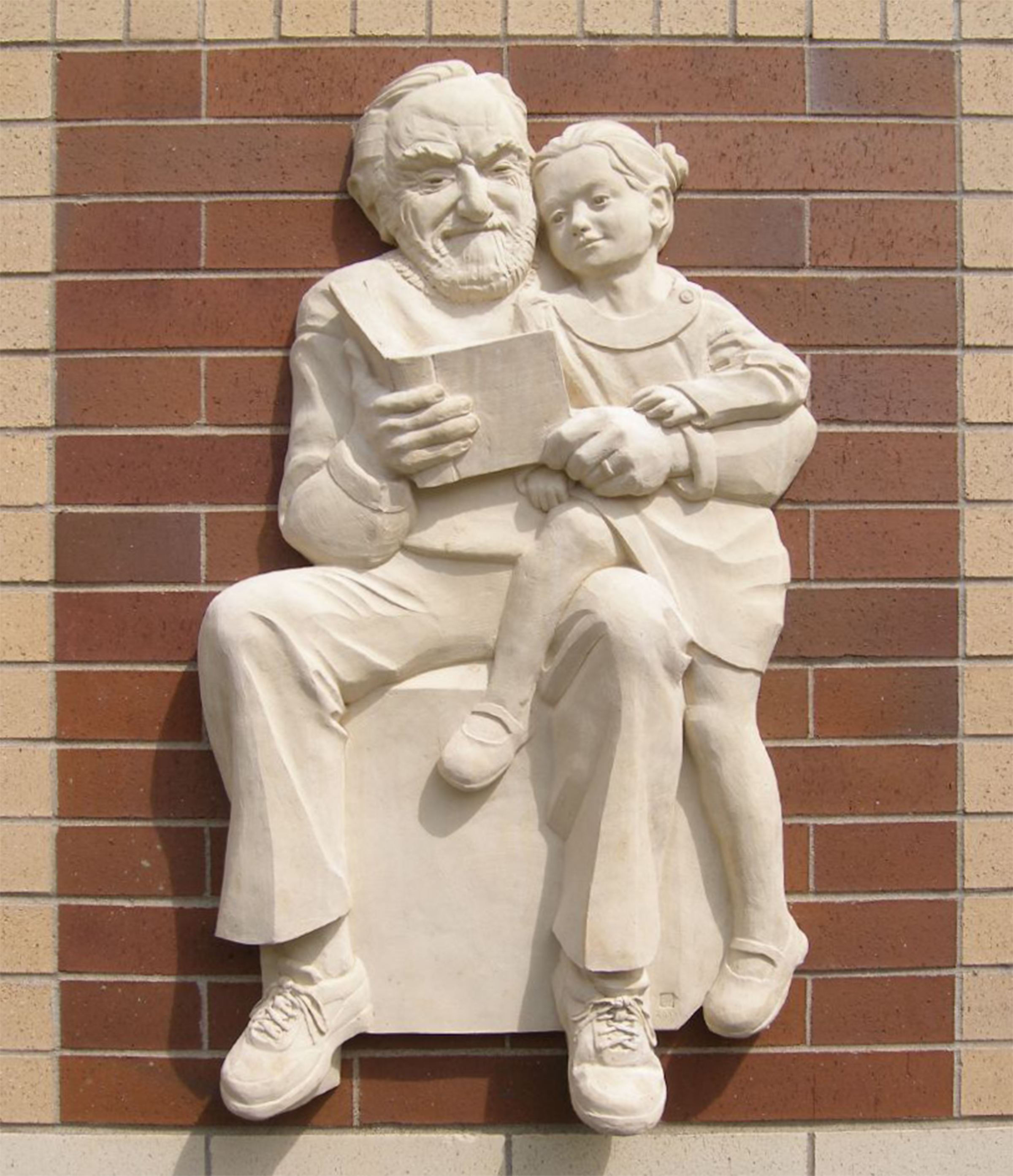 The Reader II - St. James, MN, cast stone installation, life-sized.