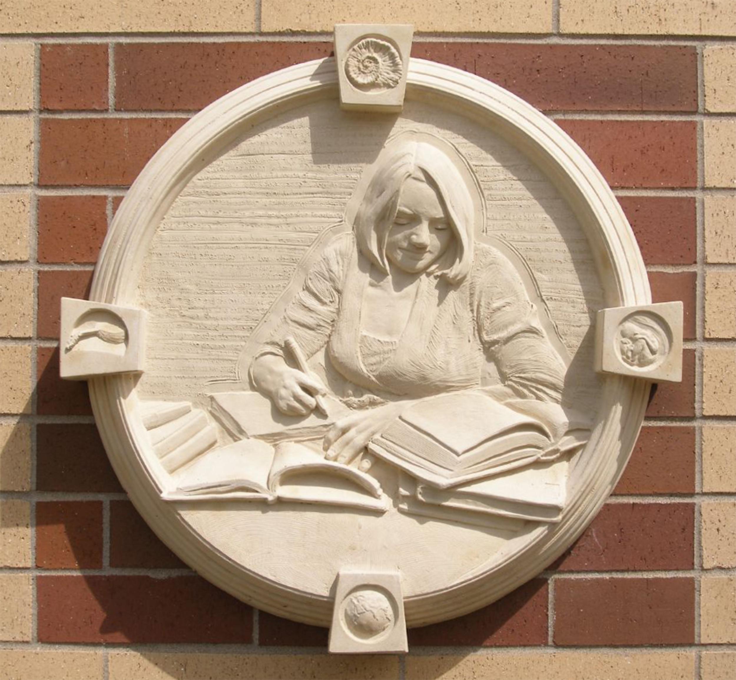 "The Reader III - St. James, MN, cast stone installation, 36"" diameter."