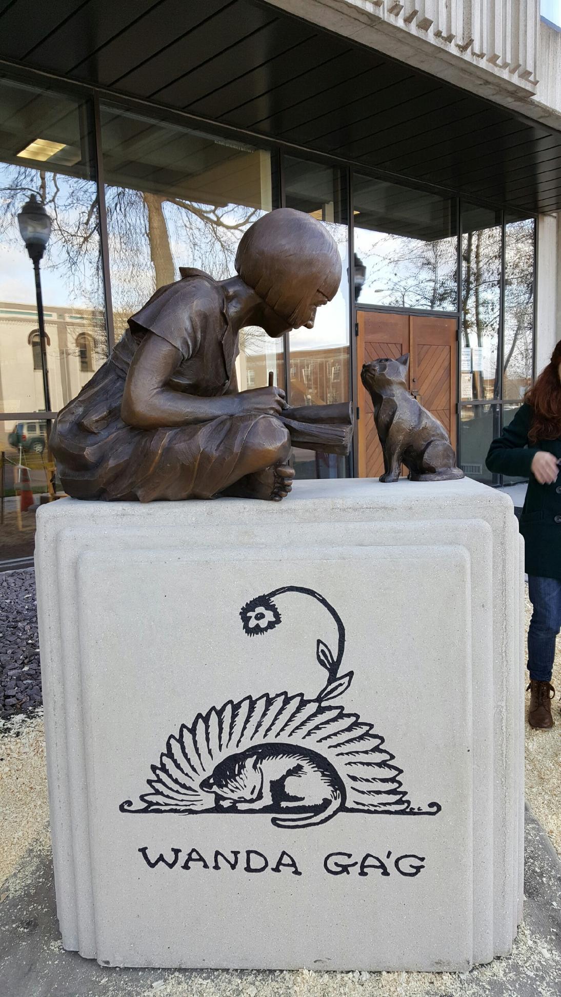 Wanda Gag Monument, New Ulm, MN, bronze and cast stone, life-sized.