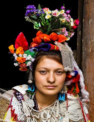 Elaborate headdresses are worn by the Drokpa of the Dha Hanu valley