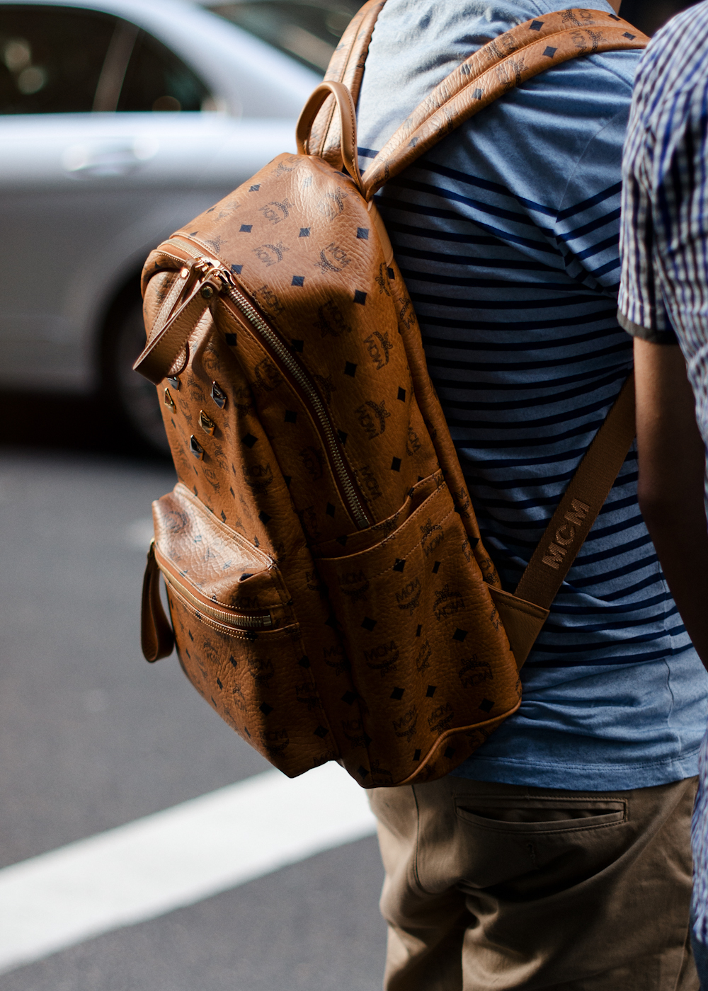 Studs and leather.   Similar look:   MCM Backpack Heritage  and   Stark  .