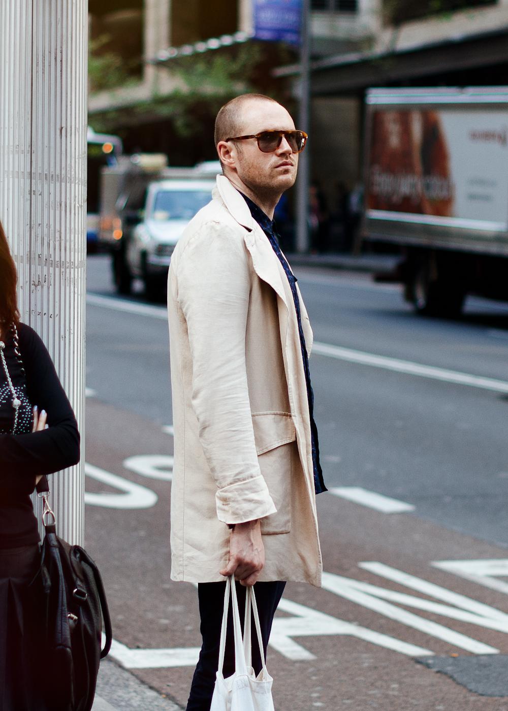 White trench.   Similar look:  Dries Van Noten Men's Royani Coat  .