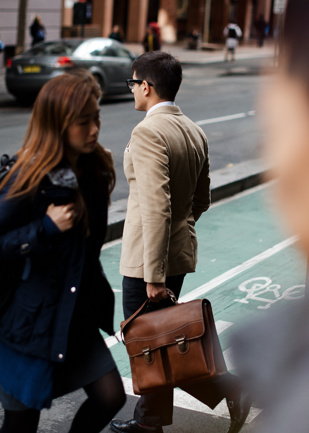 In passing.   Similar look:   Tan Smooth Leather Class Act Briefcase by Marc by Marc Jacobs  .