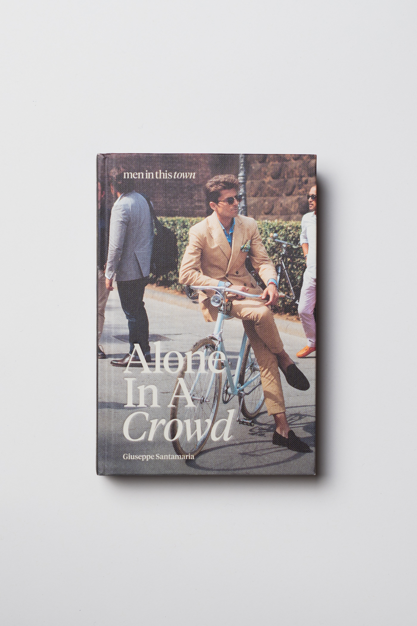 Today, I'm truly humbled to be releasing my new book,  Alone In A Crowd , worldwide! This book follows my travels from my current hometown in  Sydney  to  Melbourne ,  Tokyo ,  London ,  Paris ,  Florence ,  Madrid ,  New York  and my childhood home,  Toronto .   Some of the photos in this book focus on the menswear enthusiasts during fashion week, while others celebrate the everyday style of men — on the streets, at work and at play. Regardless of the setting, my approach has always been as an outsider looking in, observing a particular quality about someone's personal style and how they hold themselves as they go about their day.   Alone In A Crowd  is available to   order   online and is in all good bookstores  worldwide  from this week. Thank you for following along these past 7 years, I hope you love this book!  —  Giuseppe