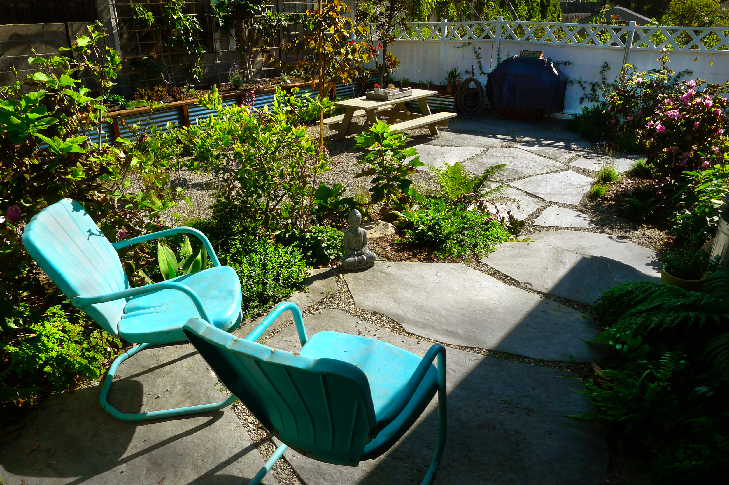 landscape and flagstone patio with bbq