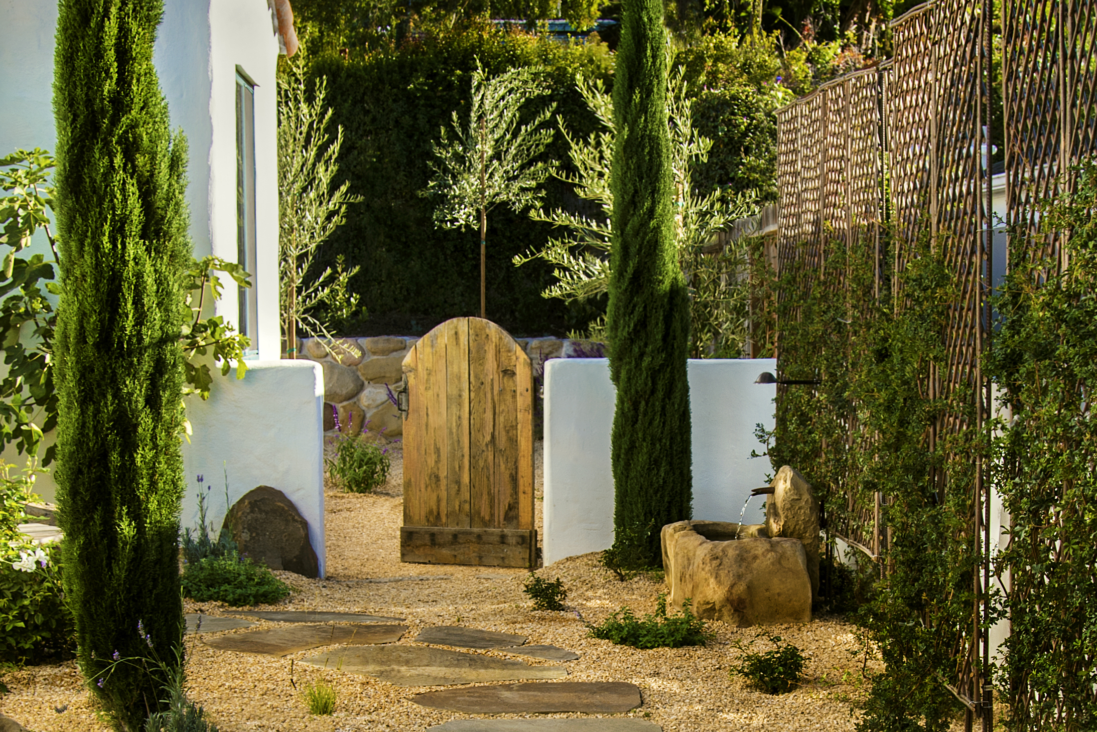 drought tolerant landscape with flagstone and fountain