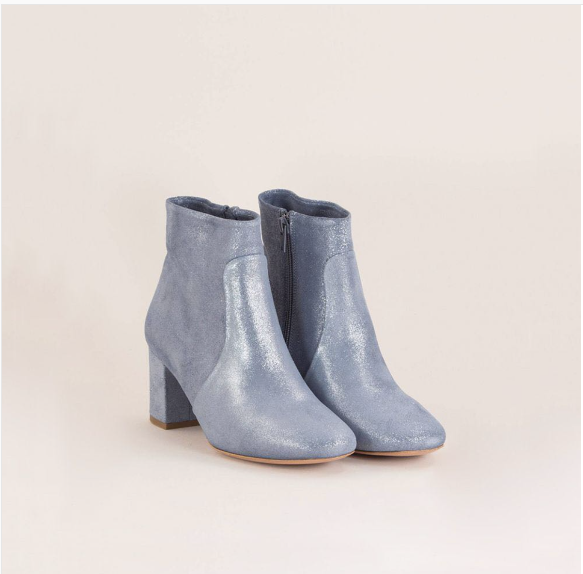 Always leave room for a pair of suede ankle boots...