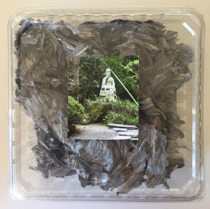 """Refuge Reliquary. Sherri Silverman. Mixed media assemblage: paper wasp nest, plastic container, collage. Created sometime between 2012 & 2016. 7.5"""" x 7.5"""" x 2.5""""."""