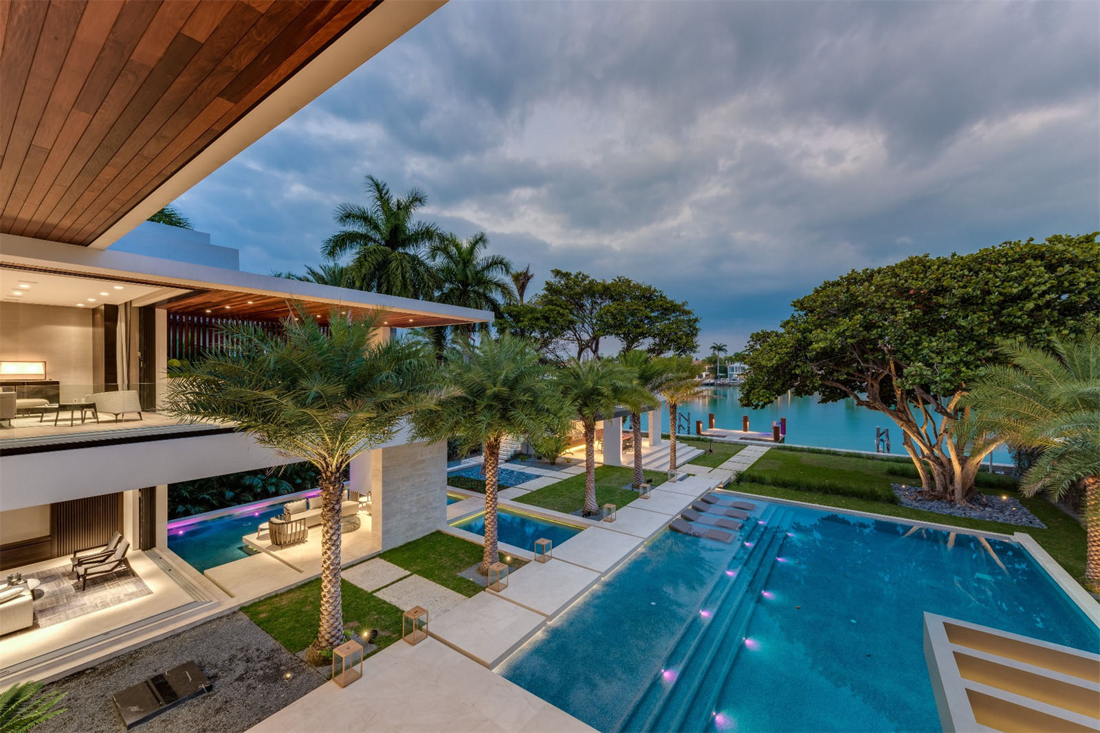 Featured Listing: Fly Through the Contemporary Palm Island Mansion With a 15' Waterfall Asking $29.5 Million