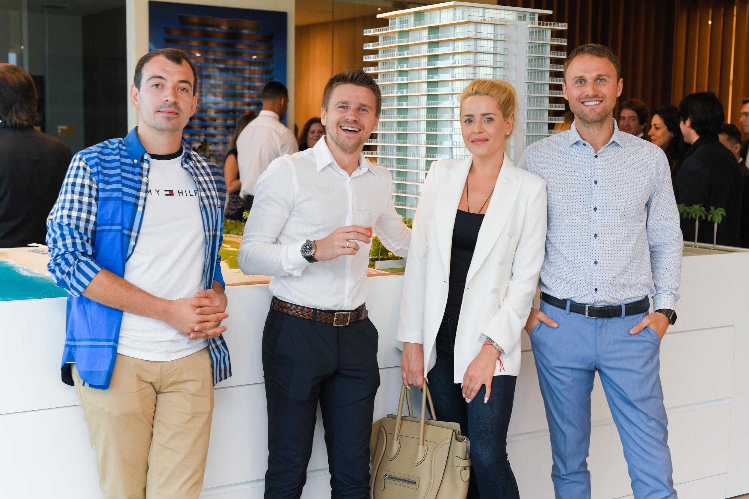 Arthur Rudchenko, Alexandra Fedorova, and Denis Smykalov with guest (far left)