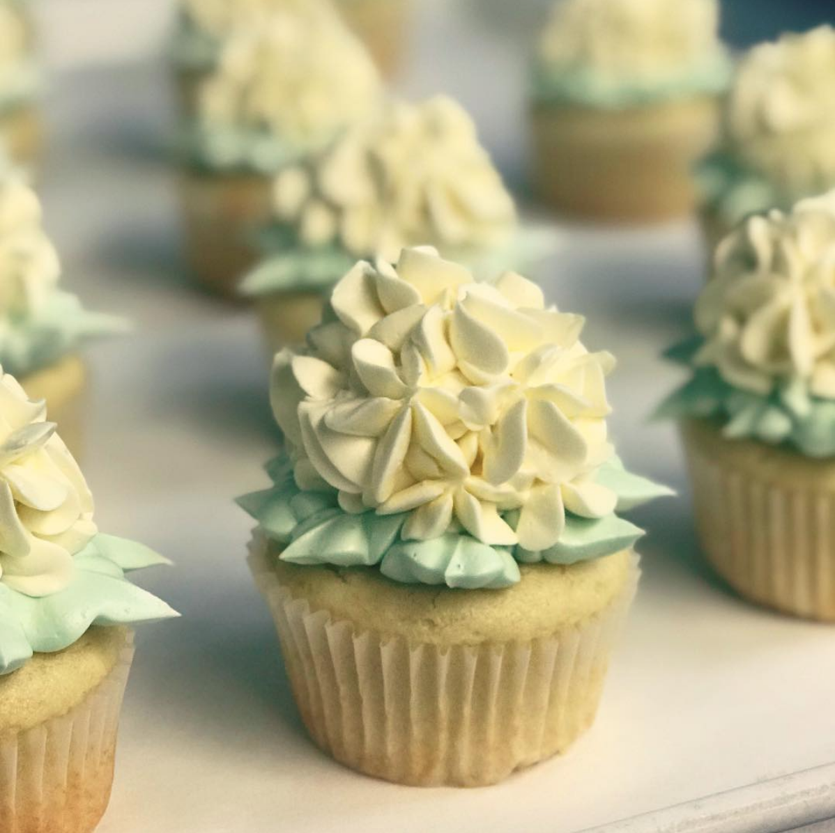 Lemon Raspberry cupcakes with a floral frosting design.