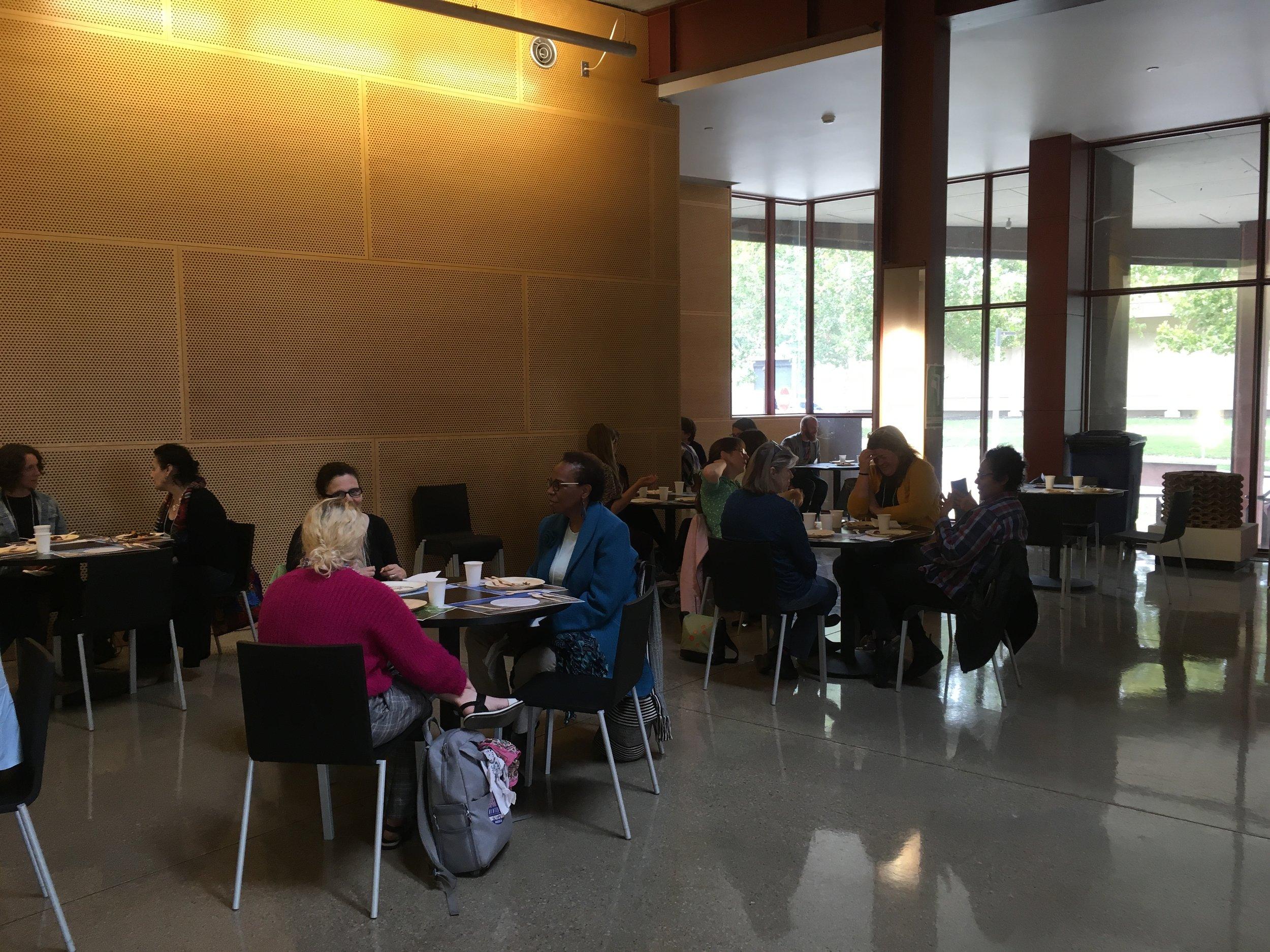 feast participants eating university of Iowa art public