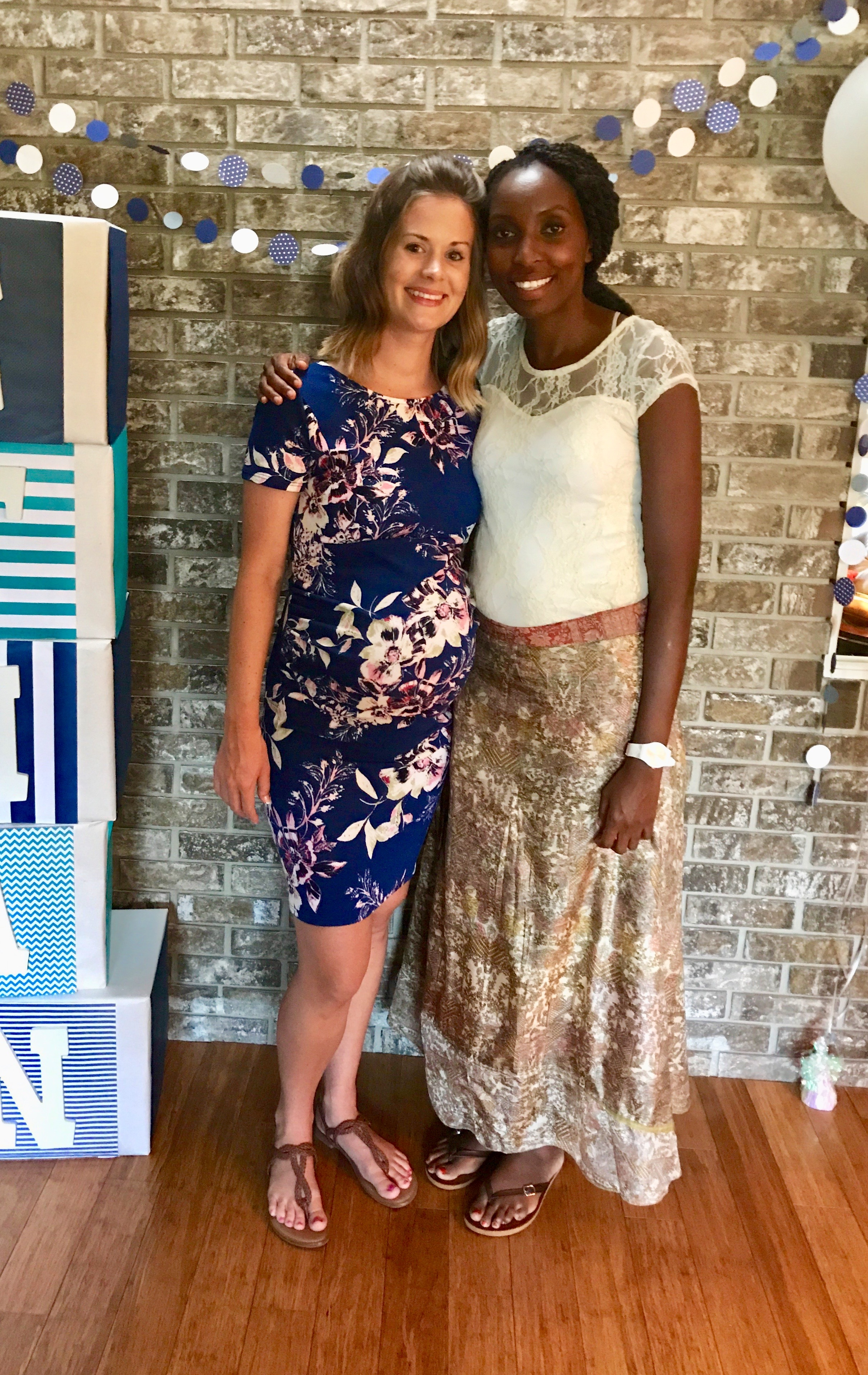 Doula Caroline with a glowing new mom-to-be at her baby shower.