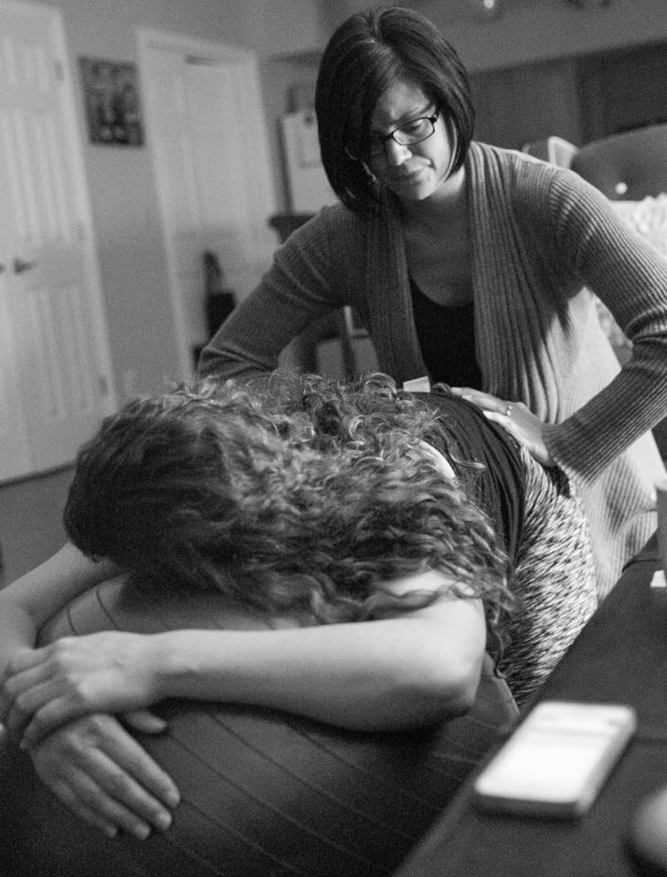 Doula Erin giving hands-on support during labor.