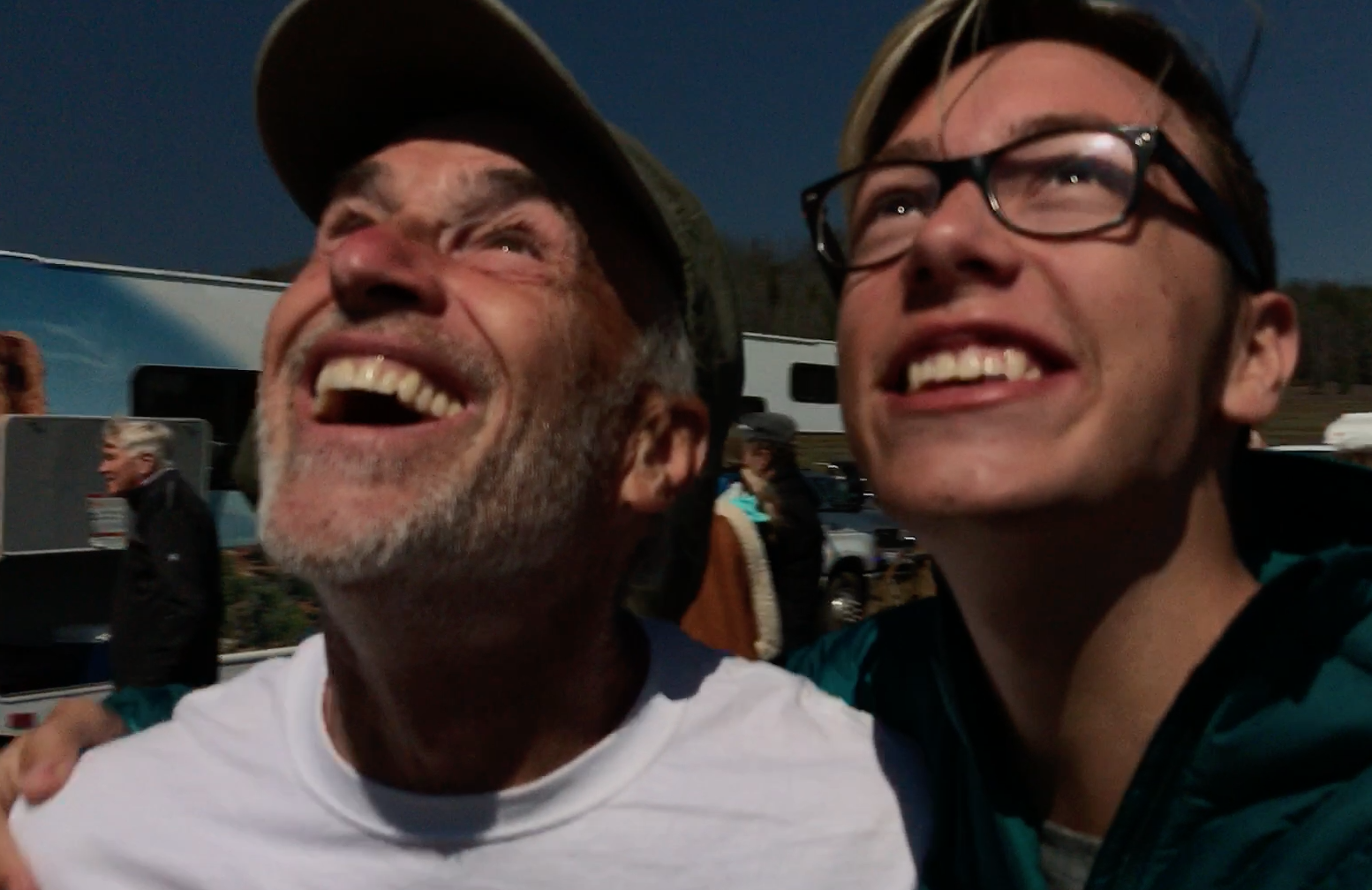 Just as the moon slipped into place my nephew Joey Torrison run up & someone captured this moment. You can SEE the eclipse not only in his glasses but in my eye.