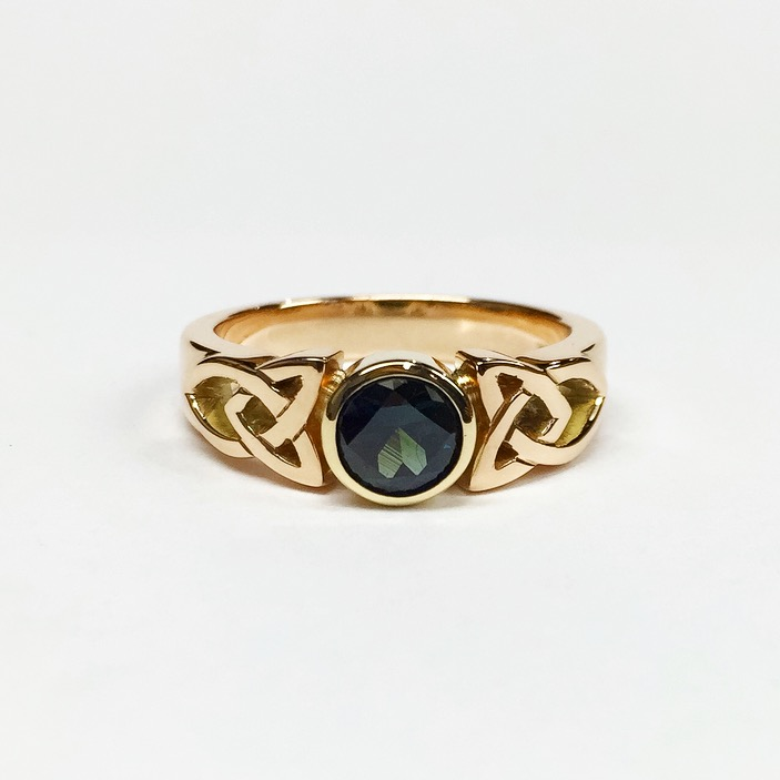 Handmade Celtic ring in 9ct. yellow gold set with an Australian sapphire.