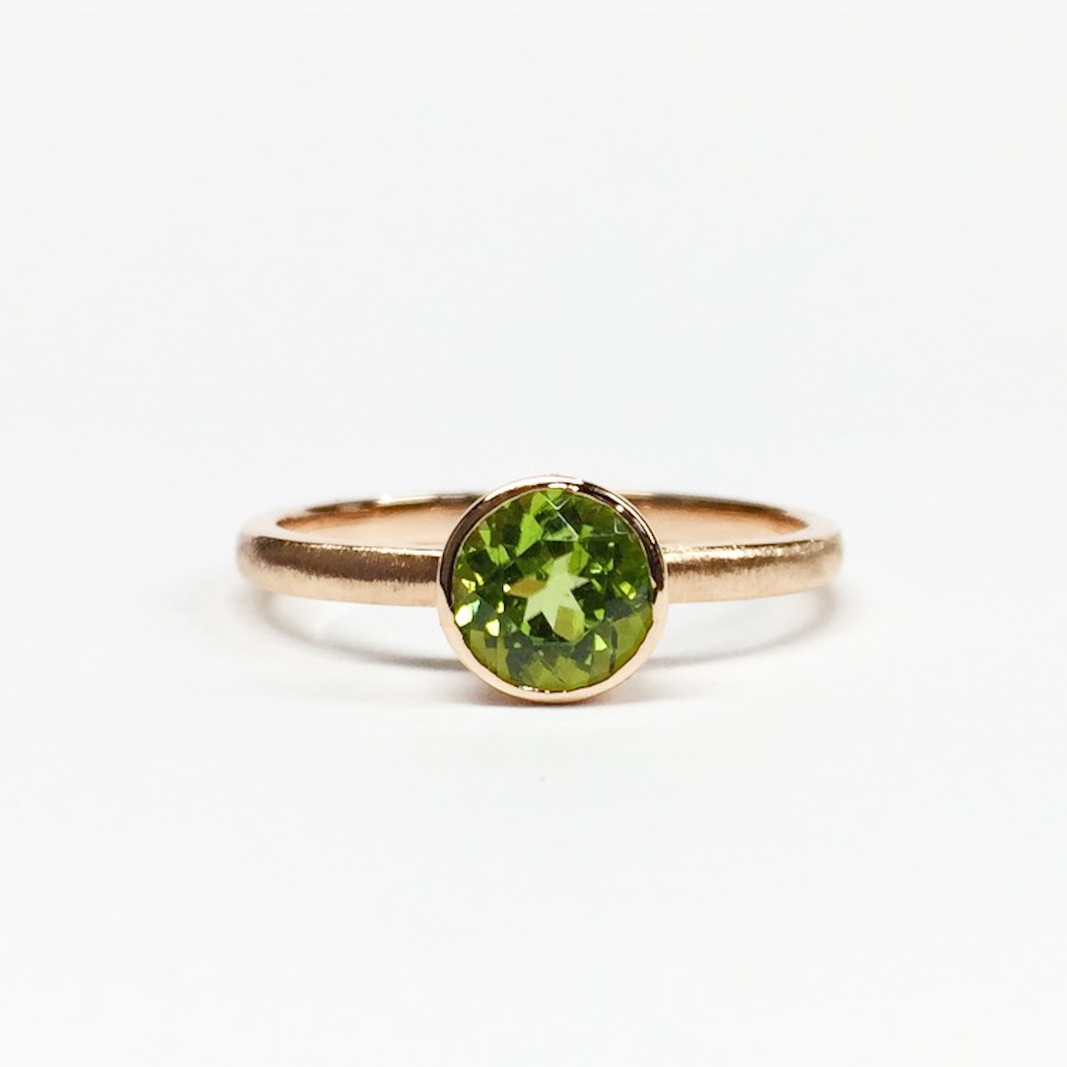Simple handmade ring in rose gold bezel-set with a beautiful peridot.